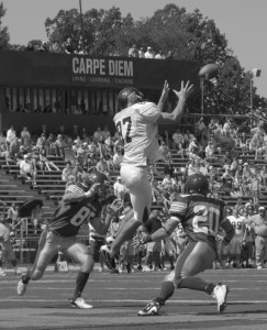 Woody Butler grabs a pass up high for McDaniel's first touchdown of the day against St. Vincent