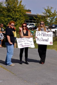 """Sarina Arahovas and Julia Pitt display their signs at the football game on september 11. this photo, posted on the """"students against self righteous Protesting"""" Facebook page, is listed in an album titled """"ignorant shit."""" Four people """"liked"""" it."""
