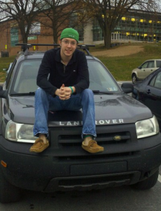 Junior Jeremy Allen poses with his 2003 Freelander Land Rover.