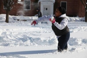 Senior, Niya Wills throws a snowball during a brawl after the snow storm. Photo by Omar Brown