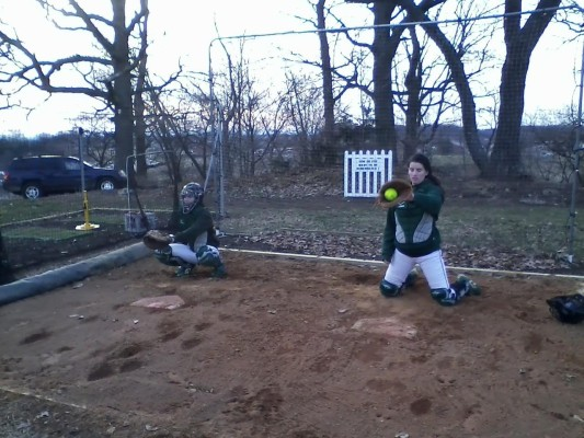 Tracy Davis and Leigh Blohm playing softball. Photo by Elec Trainor.