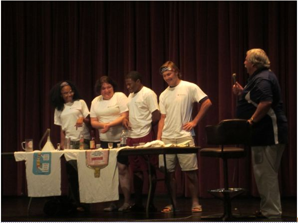 "Students volunteer to participate in a Diet Coke chugging contest on stage during a Wednesday night ""Happy Hour"" presentation by guest speaker Mike Green.."