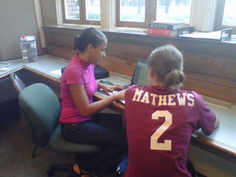 Annie Mathews assists a student during the writing process.