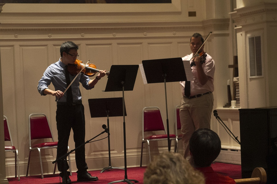 Kevin McClellan and Luis Ortiz performing a duet.