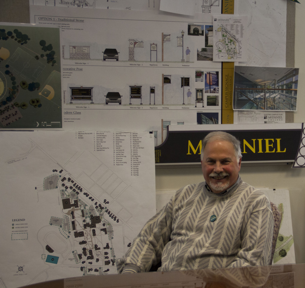 Seidel sits in his conference room, showing off the plans for expanding North Village and adding more signage to campus.