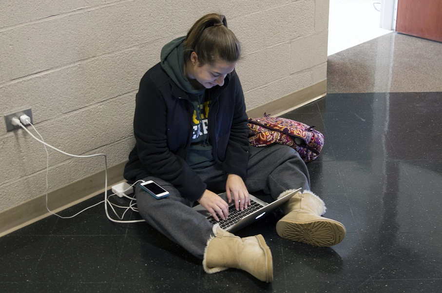 Lindsay Rothrock charges her laptop while Lewis had power for students to use.