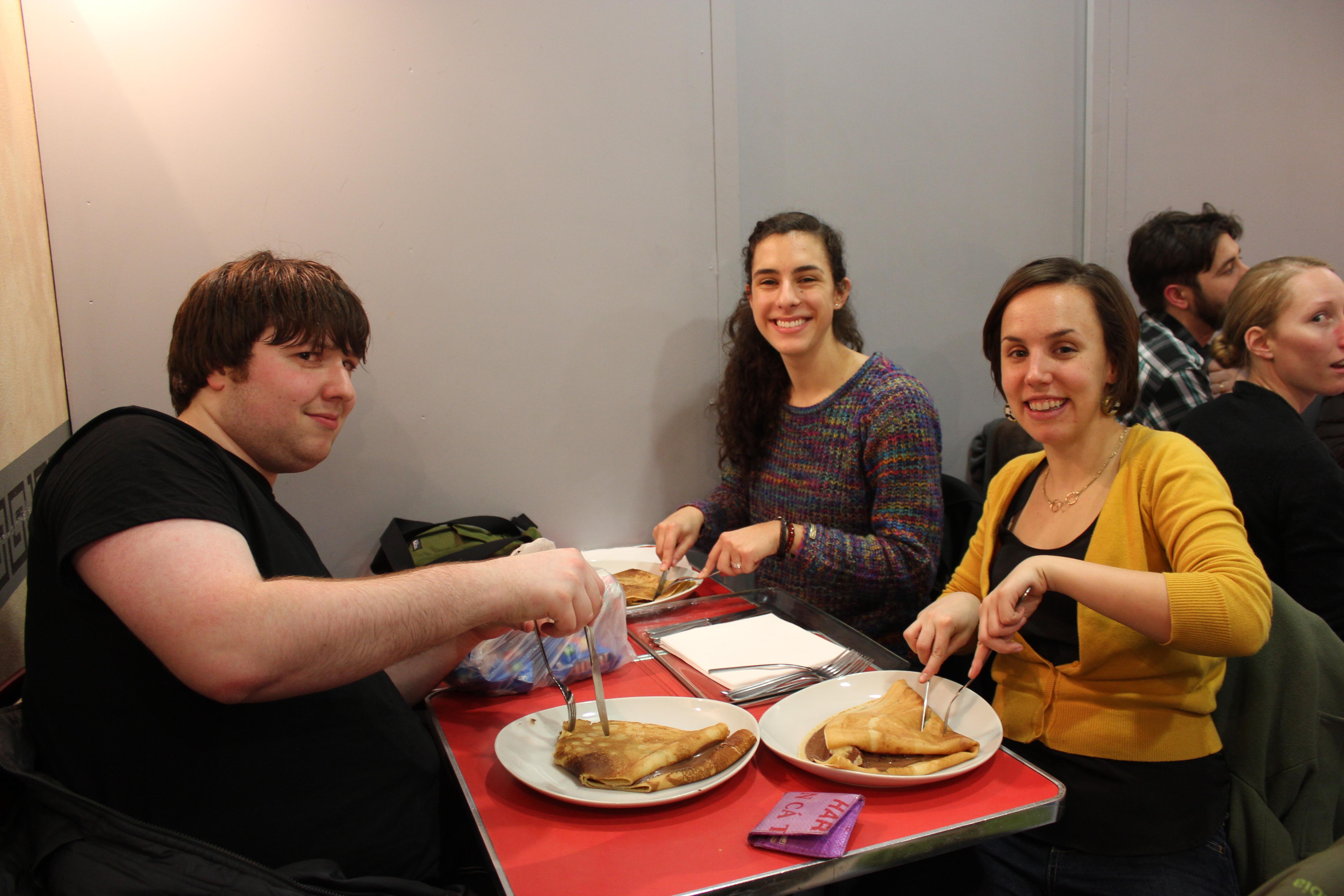 Junior Brandon Sher, sophomore Maggie Myers, and senior Amber Slater enjoy some giant crepes.