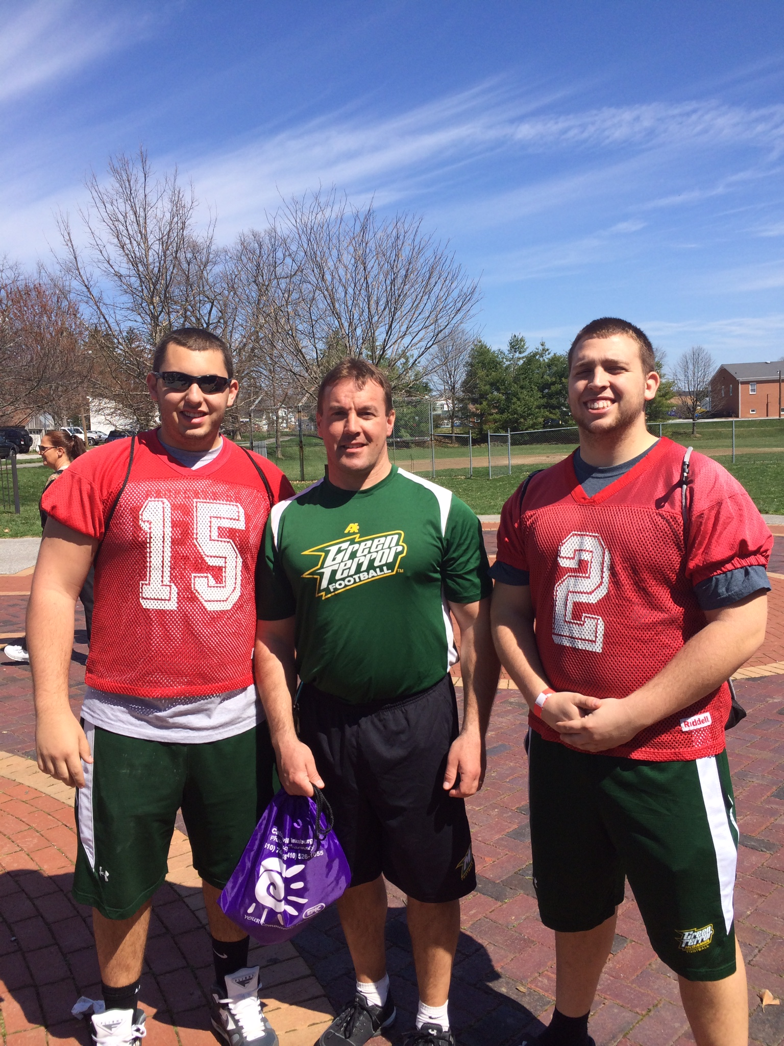 McDaniel Football kickers Ryan Lutes (left) and Douglass MacArthur (right) with Head Coach, Mike Hoyt (middle) at start of walk of Walk A Mile in Her Shoes at Dutterer Family Park in Westminster, MD