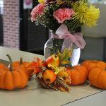 Festive pumpkin decorations at Decker College Center's Welcome Desk