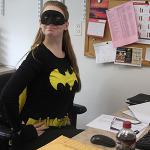 Payroll Assistant Rachel Steiner dressed as Batgirl on Halloween