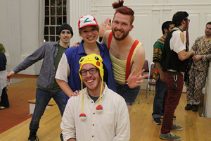 Foster McDaniel, Mary Yates, and Zach Royal dressed as Pokemon characters while Colin Evans stands in the background