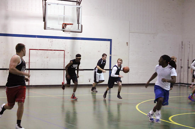 Students play intramural basketball in Gill Gym.  Photo by Nikki Krug.