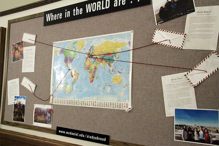 A map across from the International Programs Office features profiles of McDaniel students who have studied abroad. Photo by Nikki Krug.