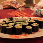 Guests at the dinner were greeted with programs, mints, chopsticks, and cucumber & avocado sushi. Pineapple juice, citron tea, and water were also available upon arrival.