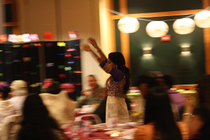 Arathy Manoharan, who performed a Bollywood dance with Lamia Rhymee, entered the audience to bring people onto the stage with her. Over a dozen people crowded onto the stage to learn part of the dance and show their skill.