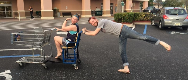 Foster McDaniel and Mary Yates playing around at a parking lot.