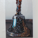 """Bell,"" Emily Johnson. Digital photo and beads. On sale for $50."