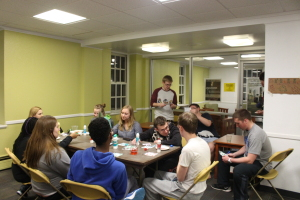 Students play environmental bingo in the main Whiteford lobby.