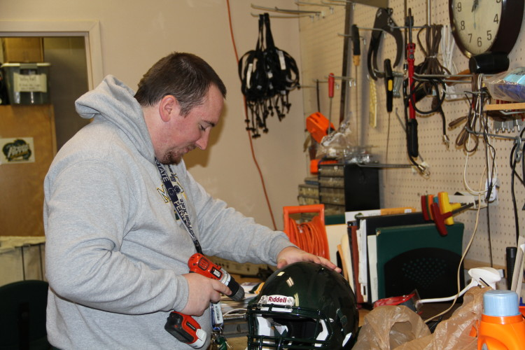 Goodyear hard at work preparing football helmets.