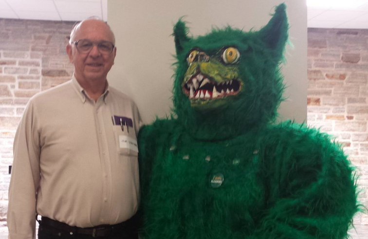 Dr. James Lightner poses with the Green Terror mascot at the latest SAC mug event.