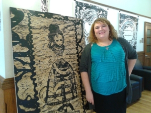 Maggie Heller posing with her woodblock