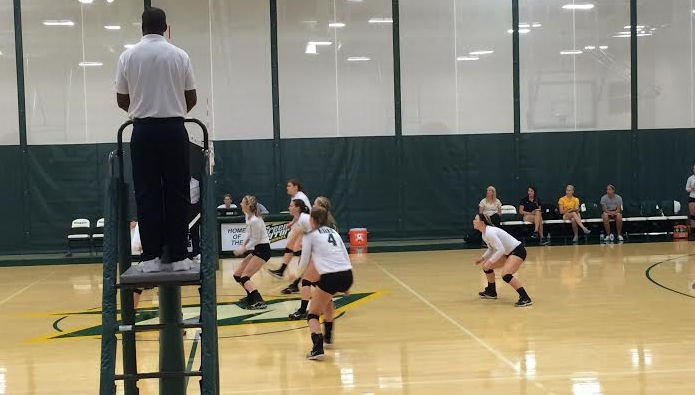 The Green Terror half of the court looks to organize during play in their 3-0 win over Ursinus.