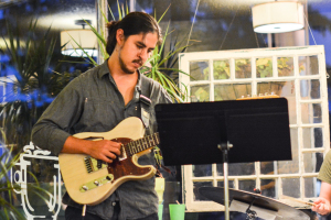 Eron plays guitar during his group's performance. Photo by Kyle Parks.