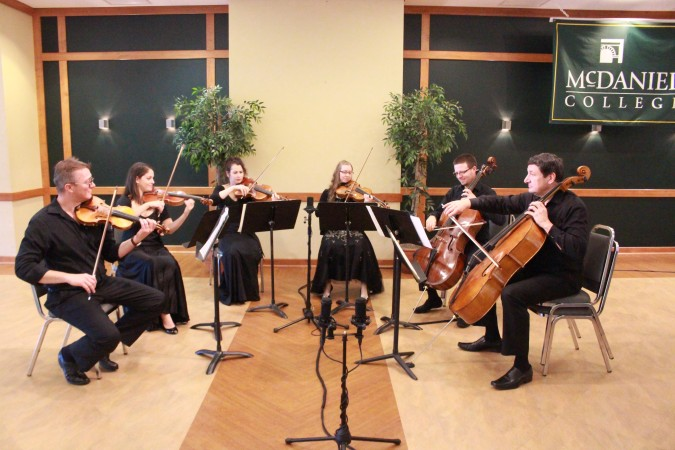 Musicians performing Luigi Boccherini's Sextet in f minor, G. 457, photo credit Jimmy Calderon