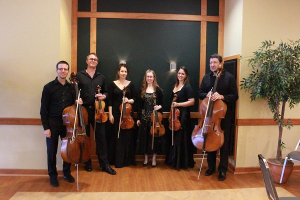 Musicians posing for a picture after the concert. Photo by Jimmy Calderon