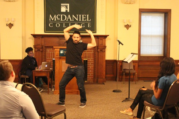 Comedian Joe Hernandez-Kolski dancing during his performance. Photo by Jimmy Calderon