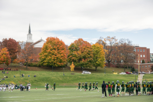 McDaniel's buildings, along with colorful trees, provided a vibrant background for a football game on Halloween.