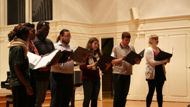Madrigals performing at the Talent Show, days after the College Choir Concert. Photo by Danielle Fatzinger