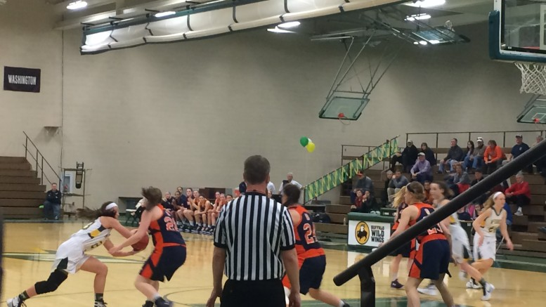 McDaniel's Lindsey Nichols looks to pass by Gettysburg's Teal Tasker.