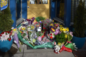 By midday on Saturday, Feb. 20, a memorial formed outside of Jeannie Bird's. Photo by Kyle Parks.