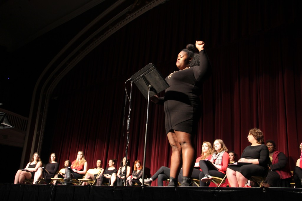 Alex Leonard raises her fist against the patriarchy. Photo by Jimmy Calderon