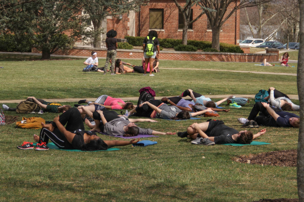 The yogilates class takes advantage of the warm weather
