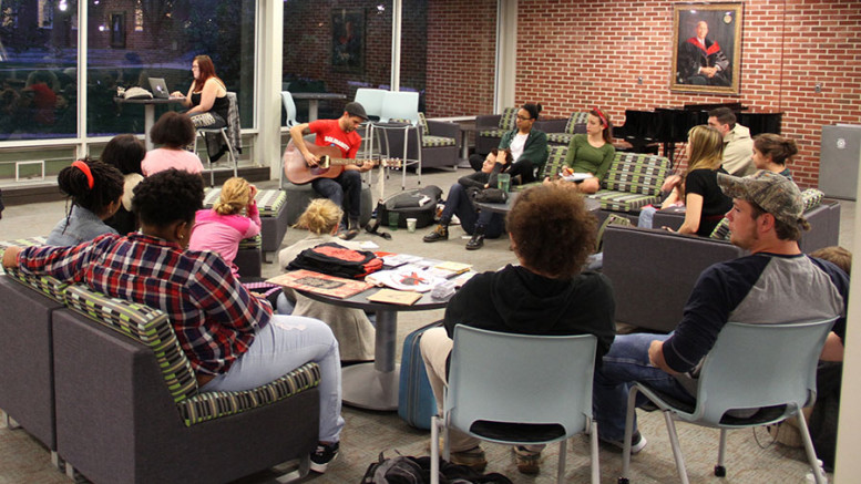 Students gather around Ryan Harvey in Ensor Lounge. Photo by Andrew Tyler