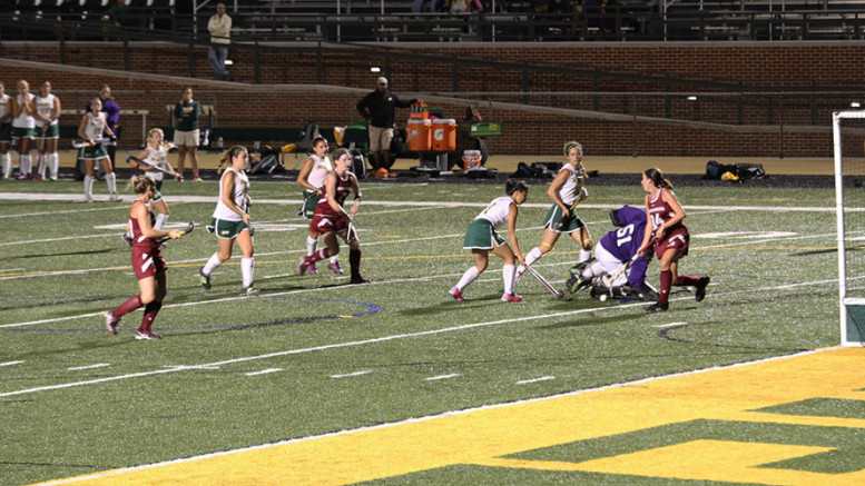 Green Terror goalkeeper Christina Gooding attempts to save a shot by the Mules. Photo by Maia Hanlon.