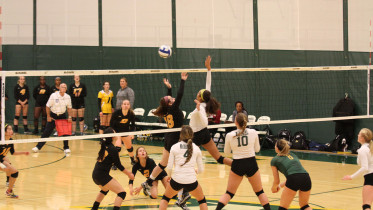 Green Terror Volleyball sets the floor in their win over Bryn Mawr. Photo courtesy of Maia Hanlon.