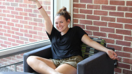 Freshman Emily McQuarrie relaxing in Decker Hall after classes.