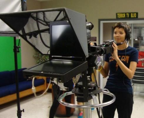 Caitlin Ramos turns on the camera.