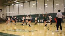 McDaniel Volleyball celebrates a point during their loss to Johns Hopkins. Photo by Casey Marson.