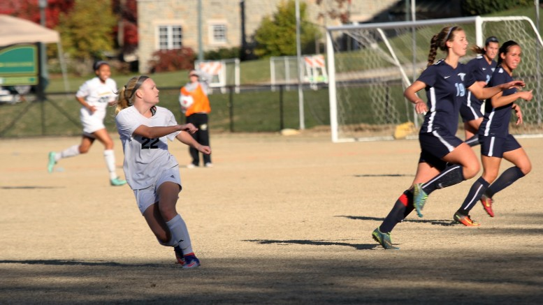 Kirsten Gibson looks to add to her team's score in McDaniel's 3-1 win over Connecticut  on Sunday.
