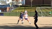 Zoë Stublarec looks to turn the ball for Connecticut College in their win over the Royals at the Westminster Regional.