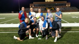 Lacrosse poses with their trophy following their fourth Intramural Flag Football Championship victory in a row. Photo courtesy of Tate Myers.