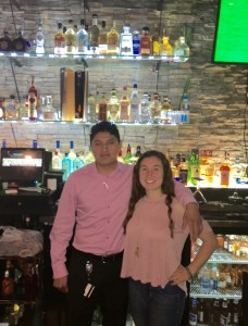 Cinco de Mayo manager Manny Goyo with McDaniel student Rachel Kling. Photo by James O'Connor.
