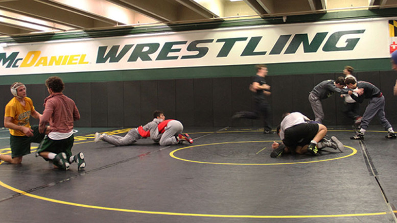 McDaniel's Wrestling team works during one of their practices. Photo by Jullienne Kay.