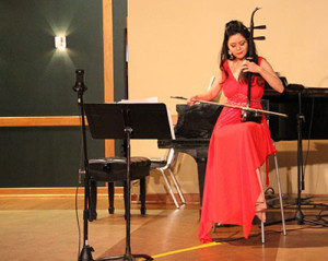 Cathy Yang playing the erhu. Photo by Lexi Corral
