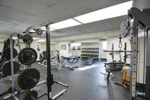 Much of the former armory's structure houses a family fitness center. Pictured is a weight room in the basement. Photo by Kyle Parks.