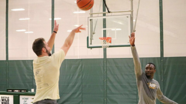 Intramural basketball at play. Photo by Eric Grantland.